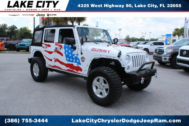 Pre-Owned 2016 Jeep Wrangler Unlimited Sport LIFTED